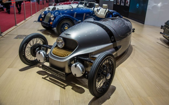 <p>Morgan is well known for its three-wheelers and in Geneva it added to that list by unveiling a battery-electric version called the EV3. This all-electric model is a first for Morgan. The EV3 uses a 46 kilowatt electric motor with a 20kWh lithium battery to produce 62 horses and hopefully, a proclaimed 241 kilometres of fun on a single charge. It retains its old school style and charm, even though it was decked out in a silver paint scheme.</p>
