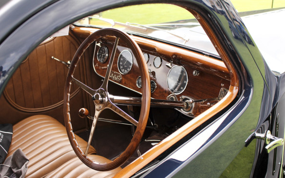 <p>The Bugatti is as impressive inside as out, with its hand-crafted leater and wood finishings.</p>