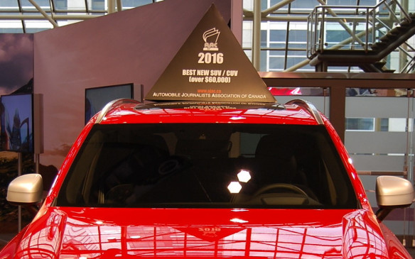 <p>The Automobile Journalists Association of Canada (AJAC) displays car toppers to identify its winners each year at the show.  This 2016 Volvo XC90 won for Best New SUV/CUV (over $60,000) and was in the running for overall Canadian Utility Vehicle of the Year, but was beat out by the 2016 Mazda CX-3.</p>