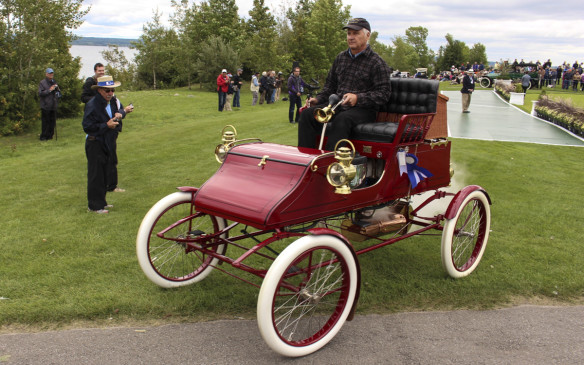 <p>The oldest car in the competition was this 1903 Stanley Steamer, seen to be trailing a spray of steam as it drives off the award platform. There was one older vehicle at the Concours – an 1898 Locomobile, which was part of a Musem display, featuring cars from automotive museums in Canada and the U.S.</p>
