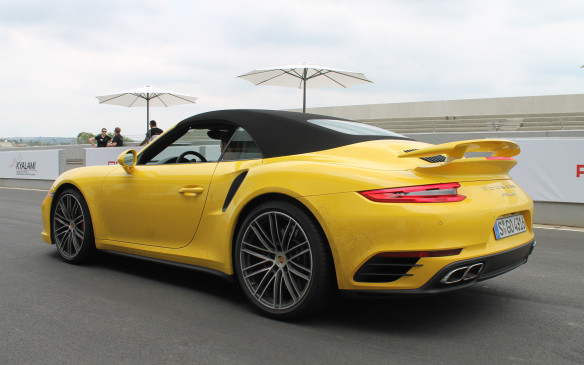 <p>Both Turbos are 28 mm wider at the rear wheels from other AWD 911s, and 72 mm wider than 2WD models. The stock 20-inch wheels are 305/30s at the back, making them a half-inch wider than before.</p>