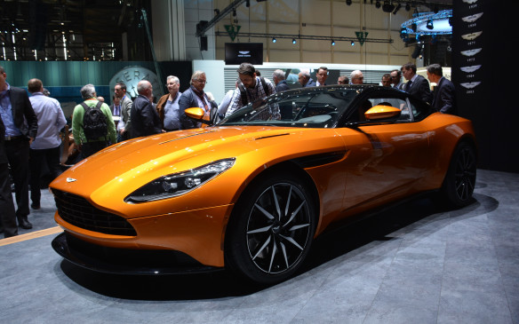 <p>The Aston Martin DB11 replaces the DB9 (DB10 was exclusively created for the James Bond movie 'Spectre') and is an all-new design, built from scratch. That means a new aluminum body shell, suspension and interior. Under the hood of this supercar is a twin-scroll turbocharged 5.2-litre V-12 engine with 600 horsepower and 516 lb-ft of torque. It's said to achieve a 0-100 km/h sprint in 3.9 seconds with a top speed of 322 km/h.</p>