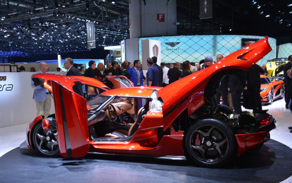 <p>Koenigsegg is always a big hit at the European shows and the little company trotted out three seductive vehicles in Geneva: the Regera, the Agera and the One of 1. The plug-in hybrid Regera, which is scheduled for low-volume production, stood out not only for its looks and multiple openings but for its 5.0-litre twin-turbo V-8 engine plus three electric motors that astonishingly achieve a combined output of more than 1,500 horsepower. It tips the scales at just 1,500 kilograms and reportedly can get up to 300 km/h.</p>