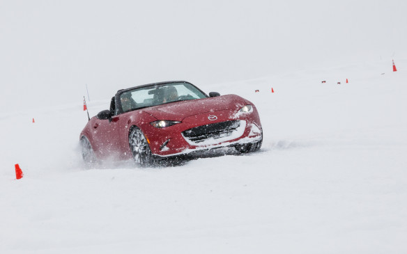 <p>This event wasn't all work – Mazda tossed in a bit of fun as well. The crew had worked for six weeks prepping the site with a thick ice base. Thoughtfully, their efforts included building a large skid pad – and Mazda added the finishing touch by providing a clutch of MX-5 roadsters. No, they didn't have i-ACTIV AWD, but they did promise the ultimate dose of pure driving fun. Actually, it was a bit surprising to discover how well these sporty two-seaters can cope with such adverse conditions. While most MX-5 owners have their gems tucked away for the winter, we were invited to toss our fleet around on the icy, snow-laden autocross layout like kids with a new toy.</p>