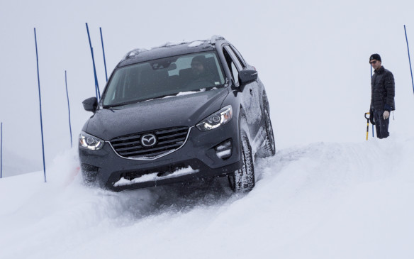 <p>Mazda partnered with Bridgestone Tires in this event, with that company supplying its WS80 Blizzak winter tire for the vehicles. One of the modules of the Ice Academy was a comparison between all-season tires and winter rubber. Identical CX-3s were used for this exercise and although one anticipated the winter tires would be superior, the degree of difference was surprising. Drivers were required to launch from a standstill and accelerate through a course of pylons before approaching a braking box. The sequence was repeated on that lap, then we switched to the other vehicle and did it all again.</p> <p>The first surprise was the noticeable difference in grip when launching the vehicle – the Blizzaks immediately grabbed with minimal spin while the all-season tires churned for several seconds before the vehicle started moving. On the run through the course, the all-seasons slipped noticeably in the turns, especially an off-camber corner, while the winter tires stayed true to the course. Braking was a no-brainer, with the Blizzaks stopping sooner as expected. The surprise, however, was how much shorter the distance required to stop was compared to the all-season tires – consistently with each driver in our group, the all-season-equipped CX-3 slid an additional 12-13 metres before coming to a stop. That's a distance that could easily be the difference between stopping safely or suffering a crash, injury or worse.</p>