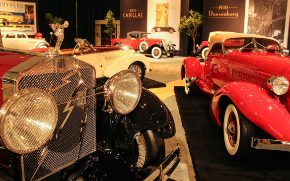 <p>The superstars of the exhibit, along with the Duesenberg and Cord, were these three rare beauties on dais at the centre of the gallery – a 1928 Isotta Fraschini (left), a 1935 Auburn Boattail Speedster (right), and a 1938 Steyr 220 (back). In the far background is a 1931 Cadillac Roadster. Even those not familiar with the significance of the models could appreciate their sheer beauty.</p>
