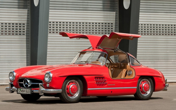 <p>The original Gullwing was a street version of Daimler's Gran Touring champion and became the fastest production car of its day. The iconic doors were necessary due to the metal cage of the cabin and made the model one of the most admired classic cars in history. A direct injected 3.0-litre inline-6 put out 212-222 hp, depending on tuning.</p>