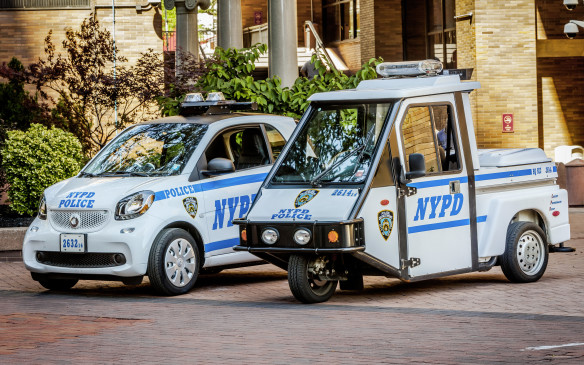 <p>NYPD Smart Fortwo with 3-wheel scooter it replaces</p>