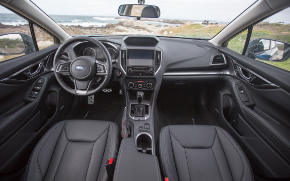 <p>The Sport-Tech includes comfortable leather seats and red and silver stitching. The interior feels very refined. It's spacious in the front and there's more room now between the seats.</p>