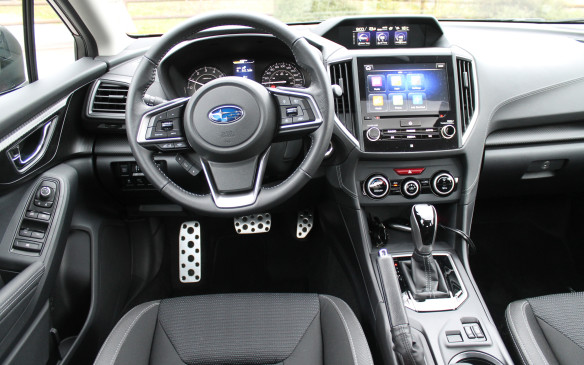 <p>The cabin seems more refined than most other cars at this price. The Sport trim comes with cloth seating, but has a larger central display screen than the less costly Touring trim – 8.0 inches compared to 6.3 inches.</p>