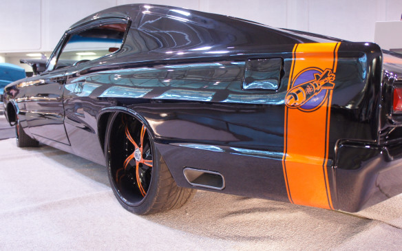 <p>This Dodge Charger looked menacing with its all-black finish, orange-accented custom wheels and subtle custom touches, such as the exhaust outlets built into the rear quarter panels.</p>
