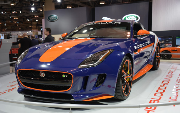 <p>A blue and orange Jaguar F-Type R Coupe stands out in the JLR display. It's all part of Jaguar's partnership with the Bloodhound SSC Project to break the world land speed record (LSR) with a rocket-powered streamliner. This F-Type R Coupe is a continuation of Jaguar's technical partnership and commitment to breaking that record. It was used for a test run to test the LSR car's parachutes in South Africa back in 2014.</p>