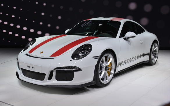 <p>Porsche tried to keep the 911 R reveal a surprise in Geneva, but the media got hold of a photo and leaked it in advance. The 911 R honours the 50th anniversary of the 1967 911 R with a limited run of 991 units to be priced at $211,000 CDN – all reportedly already sold. The R is powered by the same 4.0-liter flat six as the GT3 RS but sheds the big wing and 50 kg, as well as swapping out the dual-clutch PDK transmission for a conventinal six-speed manual gearbox. It's a beautiful specimen with red racing stripes running the length of its body and an active rear spoiler in place of the rear wing.</p>