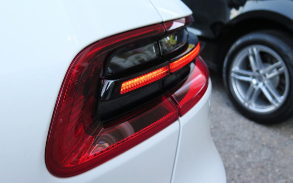 <p>The Macan's wraparound LED taillights extendinto the tailgate.</p>
