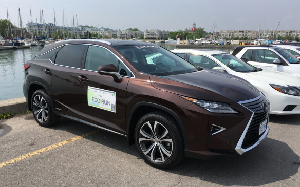 <p><strong>2016 Lexus RX 450h </strong></p> <p>The all-wheel-drive 2016 Lexus RX 450h mates the latest generation of the Lexus Hybrid Drive with a 3.5-litre, direct-injected V-6 gasoline engine with reshaped intake ports and combustion chambers to improve combustion, minimize emissions and enhance fuel efficiency. The hybrid front transaxle has a new water-to-oil cooler for improved motor/generator cooling performance at low speeds and a pre-loaded differential, while the rear transaxle combines an electric motor with a reduction drive featuring a new three-shaft configuration and aluminum case and cover to reduce weight. Packaging changes to the hybrid battery have resulted in a more compact design that improves space efficiency. The proactive AWD system engages the vehicle's all-wheel drive capability only when necessary. It also allows the rear electric motor to act as a generator to charge the battery when the vehicle is in regenerative brake mode. The EcoRun test vehicle was a Lexus RX 450h with the Executive Package, with a list price of $75,400. NRCan rates this luxury crossover at 7.7 L/100 km city, 8.2 highway, 8.0 combined. Actual fuel consumption during EcoRun was 7.1.</p>