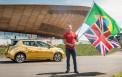 <p>Nissan gold Leaf with Sir Chris Hoy</p>