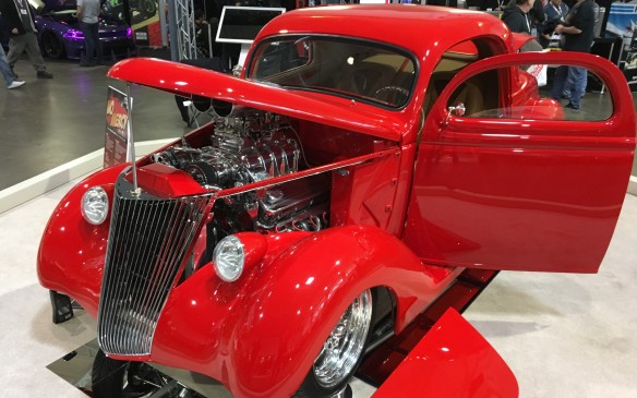 "<p>""No Mercy"" is an all-steel, Viper Red 1936 Ford three-window coupe with a 427-cubic-inch Chevy V-8 topped by a 671 supercharger, with a GM Turbo 400 transmission feeding a nine-inch Ford rear end. The interior is finished in rich Italian leather. Owned by Enzo Covello of Bolton, ON, the panel of show judges named this immaculate custom the 2017 Motorama Grand Champion.</p>"