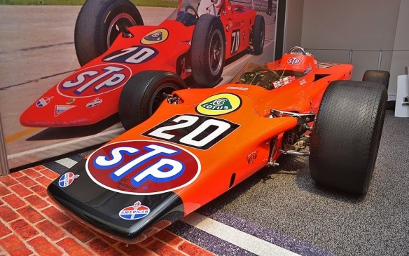 <p>Not an integral part of the AutoExotica display but adjacent to it is an exhibit that's equally exotic if not more so. It's a tribute to the 100<sup>th</sup> running of the Indianapolis 500, which takes place in May 2016 and includes eight significant cars from the great race's history. The most exotic of them all is this four-wheel-drive 1968 Lotus 56 'Wedge', powered by a Canadian-built Pratt & Whitney gas turbine engine. It was driven by F1 World Champion Graham Hill but failed to finish. Rule changes the following year effectively banned gas turbine engines.</p>
