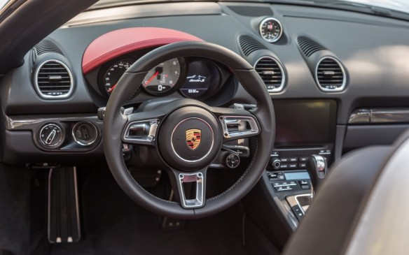 <p>The new instrument panel includes the Porsche Communication Management (PCM) system with a high-res seven-inch colour touchscreen for controlling infotainment and navigation features.</p>