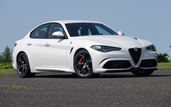<p>Soaring atop the model pyramid, the Giulia Quadrifoglio is built on the same platform as Ti models but with substantial mechanical differences, starting with its 2.9-litre, twin-turbo V-6 engine. Overall styling is quite similar but the Quadrifoglio has its own body panels, including carbon fibre hood and roof, plus a front splitter, rocker panel mouldings and a rear spoiler made of the same material. It also rides much lower than the all-wheel-drive Ti, on wider front and rear wheel tracks, which produces this much squatter, more menacing stance – a factor soon also appreciated behind the wheel.</p>