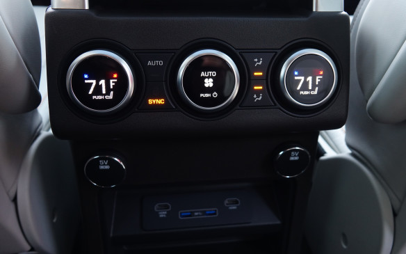 <p>Four-zone climate control is available with the various, optional Luxury Climate packages. You also have the choice of either a pair of USB or 12-volt charging points, both inexpensive extras, in addition to a couple of 5-volt power sources. Separate HDMI inputs are offered with an optional rear seat entertainment system through which passengers in the outer middle seats can listen, play or watch different pieces, games or films. In total, the Discovery can provide up to six 12-volt sockets and nine USB charging points across its three rows of seats.</p>
