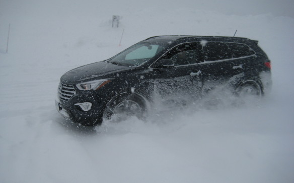 <p>The Santa Fe took the blizzard conditions at the test site in stride. The exercise included a slalom course, braking, acceleration and a ice-covered skid pad – all buried under a knee-deep layer of snow that continued to accumulate throughout the session. Still, it made for extremely challenging conditions – exactly what was needed to demonstrate the vehicle's AWD capabilities. While several drivers ended up off course (if one could even determine where the line was supposed to be), not one Santa Fe required assistance to rejoin the action. The shift in torque distribution ensured decent acceleration, the ABS got a workout in the braking zones and doing snow-doughnuts on the ice patch was a blast.</p>