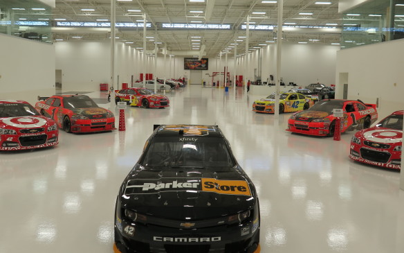 <p>This state-of-the-art facility houses the Ganassi's NASCAR efforts – the Sprint Cup teams of Jamie McMurray in the No. 1 and Kyle Larson in the No. 42 Chevrolets using Hendrick engines. McMurray has raced in all three of NASCAR's top series, winning both the Daytona 500 and Brickyard 400 in 2010. That was a big year for Chip Ganassi Racing as it won the two big NASCAR events as well as the Indy 500 that year. Kyle Larson was NASCAR's Rookie Of The Year in 2013 and the first NASCAR Drive For Diversity graduate to run the full Sprint Cup schedule. This shot was taken while the teams were in Las Vegas, explaining the empty slots.</p>