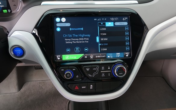 <p>A 10.2 inch touch screen with clear and crisp graphics dominates the centrally-mounted cluster in the shape of a soft-edged trapeze. Minimalist controls for the audio and climate control systems on the bottom part do a good job nonetheless, thanks to their generous size and clear markings.</p>