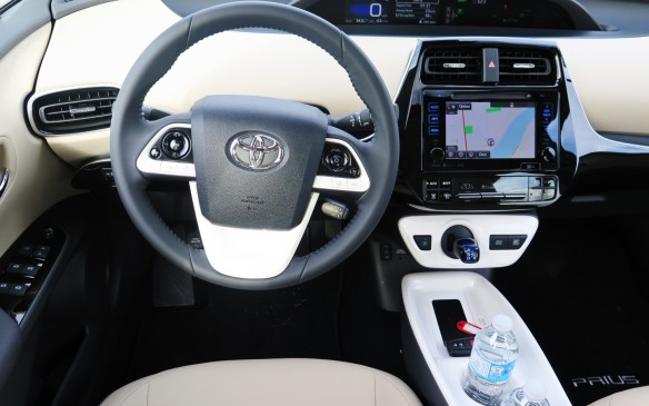 <p>The instrument cluster is in the same central position as in the outgoing Prius, but there are new graphics and a wireless charging mat on the forward portion of the centre console.</p> <p> </p>