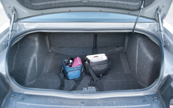 <p>No one likes to lift their groceries, luggage or belongings any higher than they have to into the trunk of their car and that's a downside with this vehicle. The trunk lip doesn't mount flush with the bumper, so you are always lifting your luggage up, over and down into the trunk.  There is no shortage of trunk space, however, so pack as much as you want.</p>