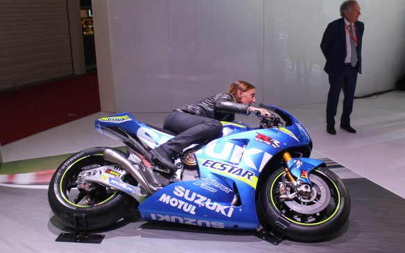 <p>Over at the Suzuki booth, show-goers could see just how far over the Moto GP bikes can lean into curves on the track.</p>