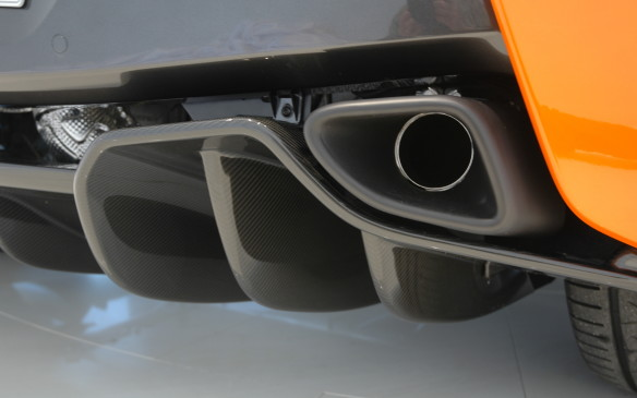 <p>Another key difference from higher-end models is the 570's equal-length exhaust headers which run below the engine instead of above it. Lurking quite discreetly within a very un-subtle (but aerodynamically functional) rear splitter, the tailpipes have a distinctly different sound from those of other McLarens.</p>