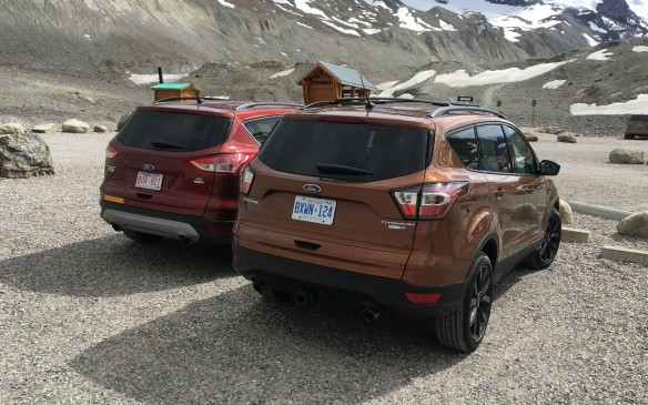 <p>Subtle new sculpting on the liftgate and redesigned tail-lamps help distinguish the 2017 Escape (right) from its predecessor.   </p>