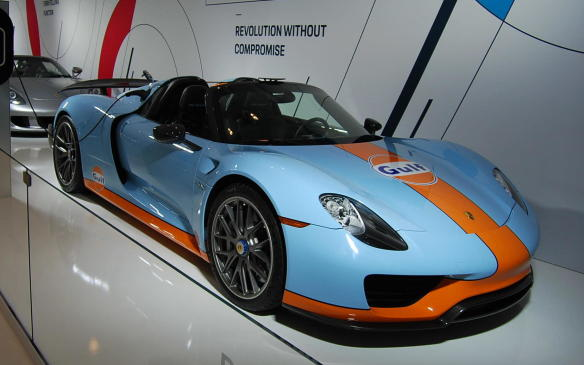 """<p>With Porsche introducing its first hybrid 918 Spyder hypercar in 2013, the brand further solidified its name with performance and innovation, on and off the track. This highly-efficient yet powerful vehicle houses a V-8 that works in conjunction with two electric motors to produce 887 hp; hence the name """"hypercar"""".</p> <p></p>"""