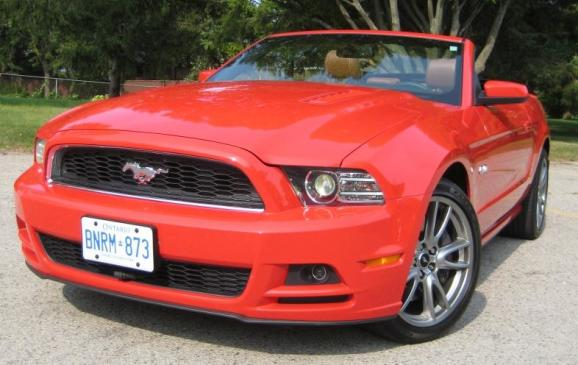 2013 Ford Mustang GT convertible - front 3/4 view low