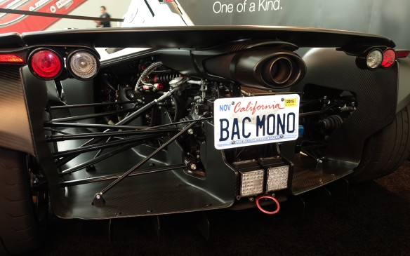 <p>A low view of the BAC Mono from the rear shows a horizontal forest of slender metallic rods, arms and shafts for the suspension, for reinforcement and to drive these huge, squat tires across the formula-like aero 'tunnels'.</p>