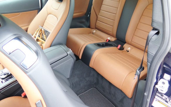 <p>The long frameless doors allow access to the rear seats, but be sure to duck below that low roof! If you can get in, there is a surprising amount of room in all directions but up. Height-challenged or small folks will be quite comfortable.</p>