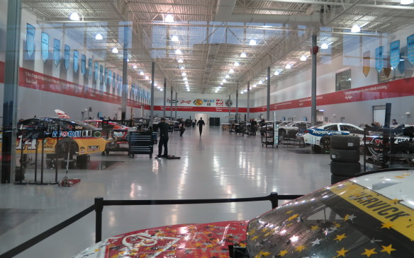<p>The team operates out of this 140,000-square-foot facility with 250 employees. The welcome centre has an array of cars in front of the glass wall where visitors can see work in progress. Like all of these race shops, the working area is spotless with excellent lighting and working conditions.</p>