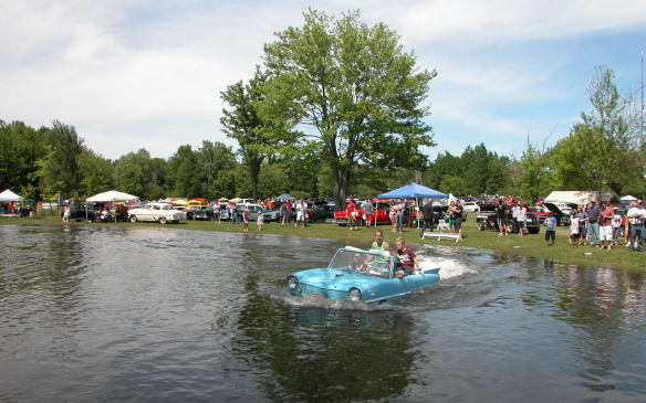 <p>In a pond on the estate, a group of Amphicars took patrons for a unique ride, splashing in at one end of the waterway.... </p>