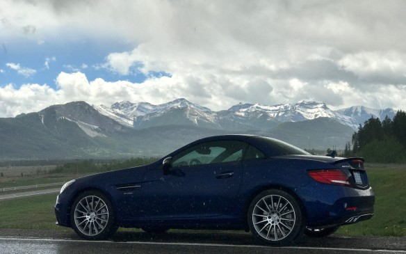<p>To stay on schedule, we flew from Regina to Calgary, saving eight hours on the highway, and then claimed an AMG SLC 43 to drive into the mountains at Canmore. The weather closed in and we finally put up the hard roof; at one point, there was hail coming from the clouds and making the highway slippery.</p>