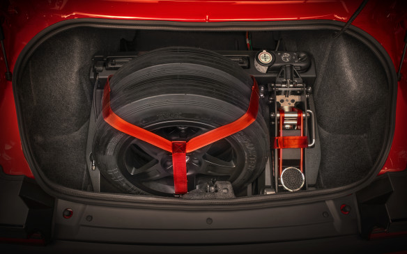 <p>Also in the Demon Crate is a custom-shape, hard foam cradle that lets you safely and snugly carry the narrow, track-only, M&H Racemaster tires – size 4.50/28.0-18 – your new track tools and the standard, plug-in emergency air compressor, neatly stashed in this top-dog Challenger's trunk.</p>