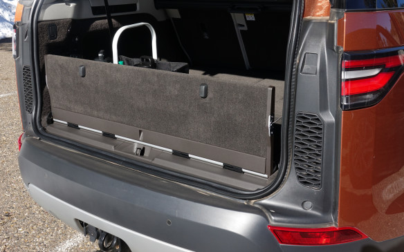 <p>To replicate the practical virtues of the previous model's horizontally-split tailgate behind the new, single-piece composite gate, the ever resourceful and imaginative Land Rover development team has created a power-operated inner tailgate for the new Discovery. When standing upright, the sturdy panel is a practical way of containing all cargo. Especially when third-row seats are erect, leaving a mere 258 litres of cargo volume between them and the tailgate. This will keep things such as grocery bags from flopping out.</p>