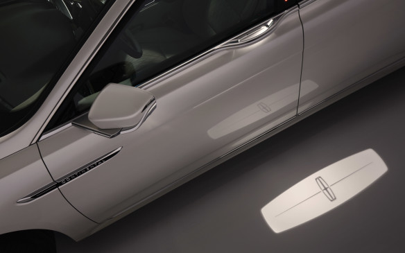 """<p>In fact, just approach the car with the key fob and the lights will come on gradually and a """"puddle light"""" will shine a Lincoln logo on the ground beside the door. This not only looks welcoming, but it also warns if there's a puddle you might step in!</p>"""