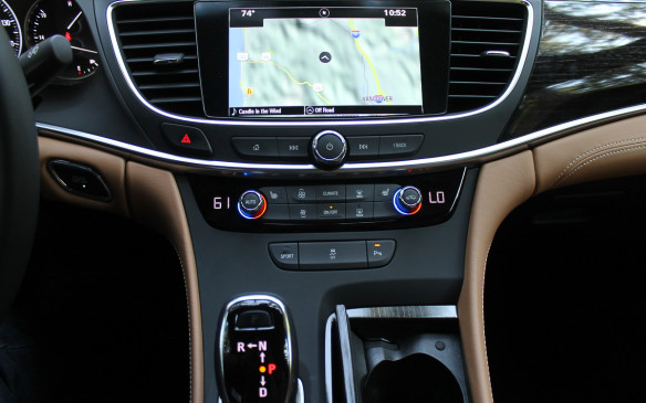 <p>The front console is less cluttered by buttons because the central display touchscreen now has many of the controls that used to take up space on the instrument panel.</p>