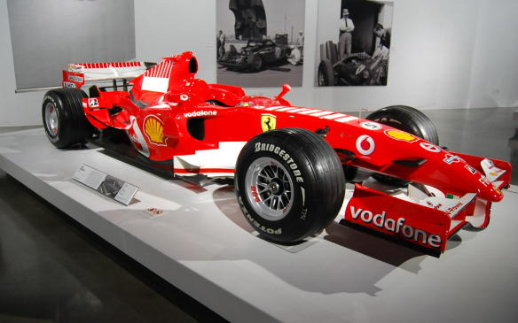 <p>The most recent car in the exhibit is this 2006 Ferrari 248 Formula 1 car, driven by seven-time World Champion, Michael Schumacher. He finished second to Fernando Alonso in the championship in that, his final F1 season, after a decade of racing for Scuderia Ferrari.</p>