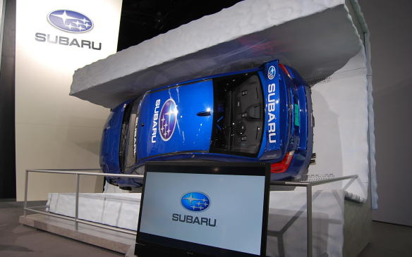 """<p>If you haven't seen it already, go to the Subaru booth and check out the bobsledding STI rally car. <a href=""""Mahle"""">The video</a> is worth the watch and the display is worth a few photos as well. Wonderful!</p>"""