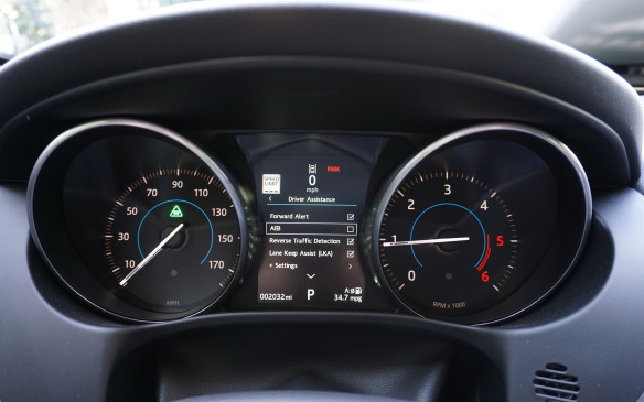 <p>The XE's gauge cluster is pretty conventional, with physical speedometer and tachometer flanking a multi-functional colour centre display. The low tach red line and average fuel economy shown on this US-spec car (34.7 mpg US equals 6.8 L/100 km) indicate it's a diesel. Note the speed limit display – an on-board camera spots and displays changing speed-limits as you drive by. Intelligent Speed Limiter can also automatically adjust your speed to the limit.</p>