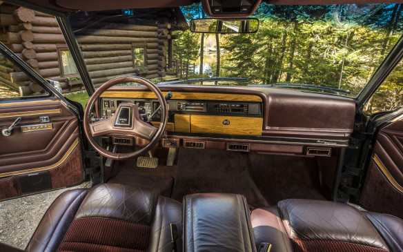 <p>The Grand Wagoneer was luxurious, with air-conditioning, leather upholstery, and AM/FM/CB radios as standard.</p>