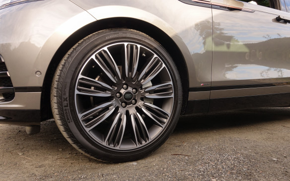 <p>Designers love big alloy rims that make even mid-size luxury SUVs look slender by filling wheel wells and minimizing the black rings of rubber. The Velar First Edition we drove in Norway had these 22-inch wheels, wrapped with low-profile tires in size 275/40R22. They make the Velar look great at a standstill, track nicely on smooth asphalt but also jar its passengers vigorously on a rough trail or a jagged country road. Several other wheel sizes are available, from 18 to 21 inches in diameter. They are worth consideration if you don't plan to drive your Velar only on billiard-table smooth roads.</p>