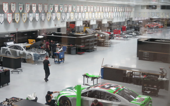 <p>The raised viewing area, among the many welcoming elements of the JGR Shops provides an excellent opportunity to see the teams in action. Cars being prepped here include those for both the Sprint Cup and Xfinity series where JGR fields teams for Daniel Suarez, Erik Jones and Deny Hamlin. JGR also has a large visitor centre and gift shop area<strong>.</strong></p>